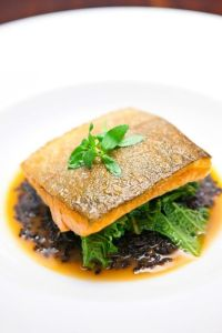 Tasmanian Sea Trout, forbidden rice, mustard greens, kimchi butter sauce, rice paddy herbs